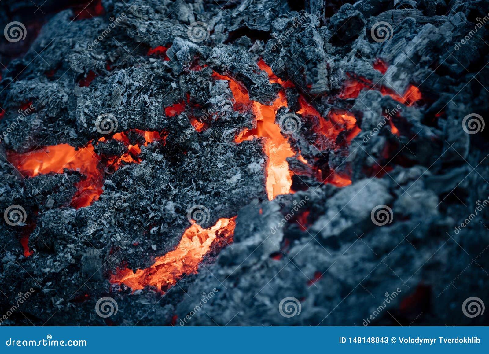Lava flame on black ash background