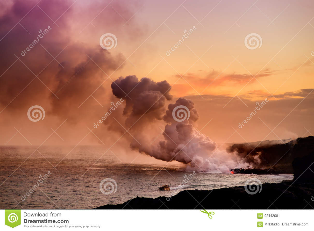 Lava pouring into the ocean creating a huge poisonous plume of smoke at Hawaii`s Kilauea Volcano, Big Island of Hawaii