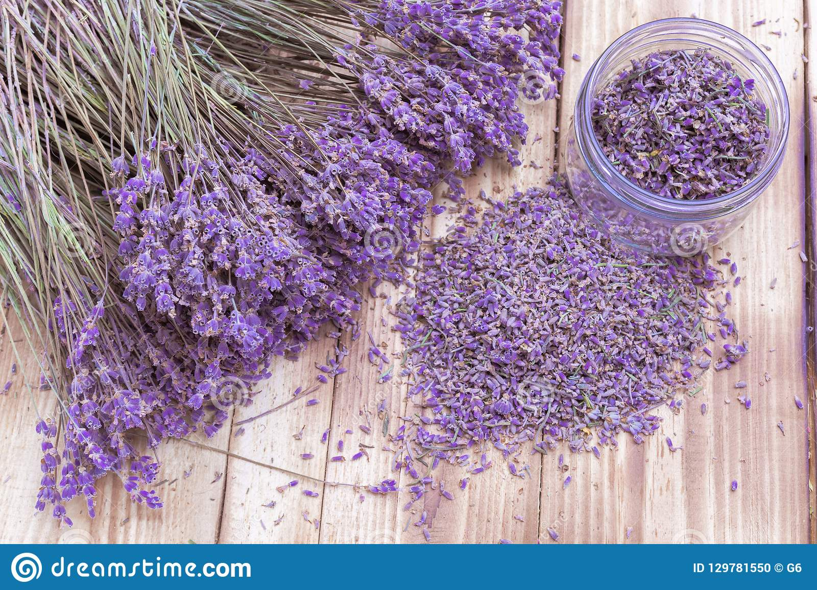 Lavender Dried Flowers In Jar Scattered And Bunch On Wooden Desk Stock Photo Image Of Bouquet Desk 129781550