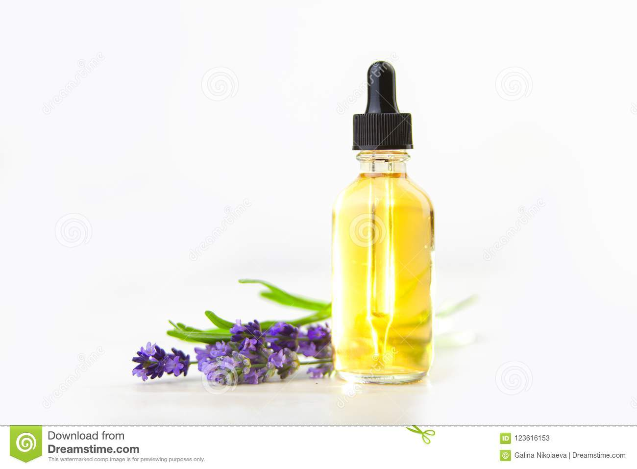 Lavender Essential Oil In Beautiful Bottle On White Background Stock