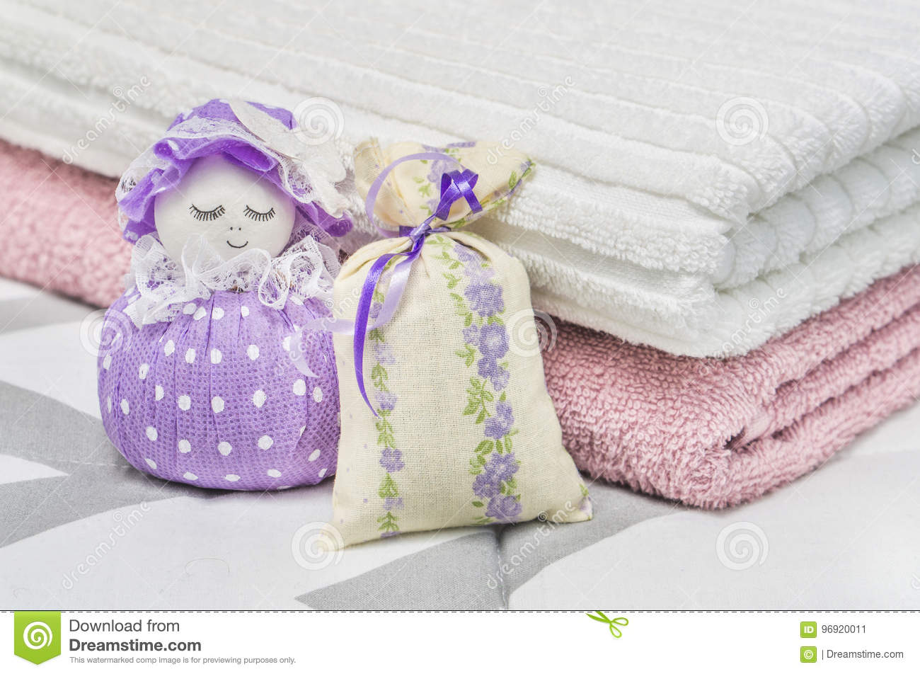 Lavender sachet and scented pouch figure and character representing a girl or woman. Close up to dried lavender in decoration bags