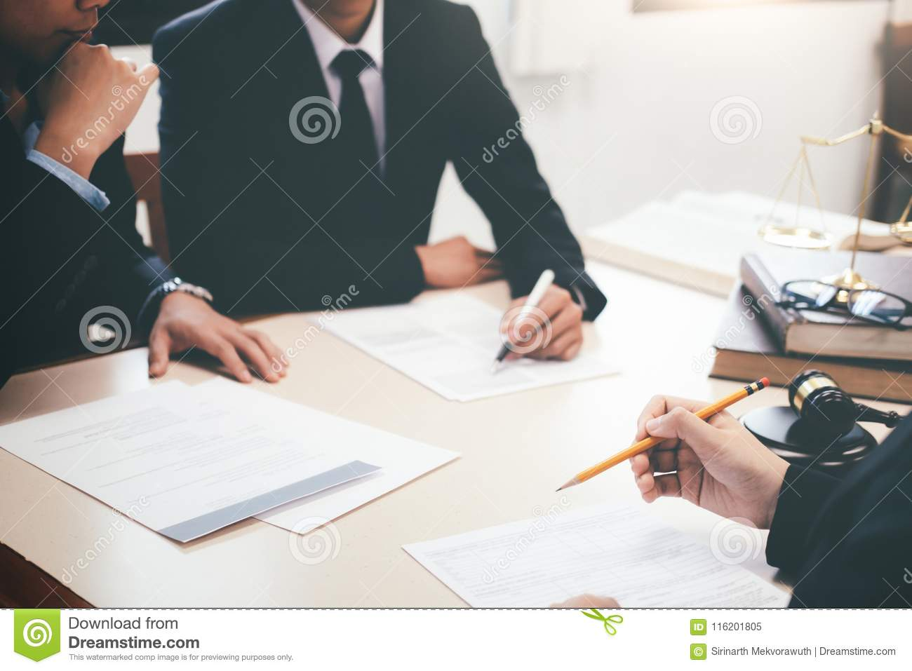 Lawyer and attorney having team meeting at law firm.