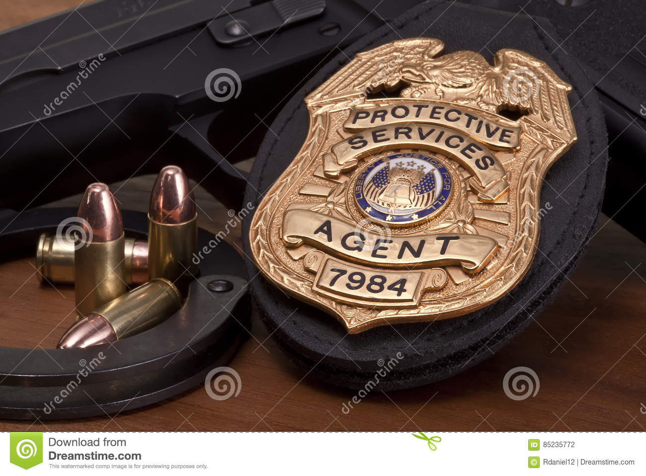Law enforcement badge with gun, handcuffs and bullets