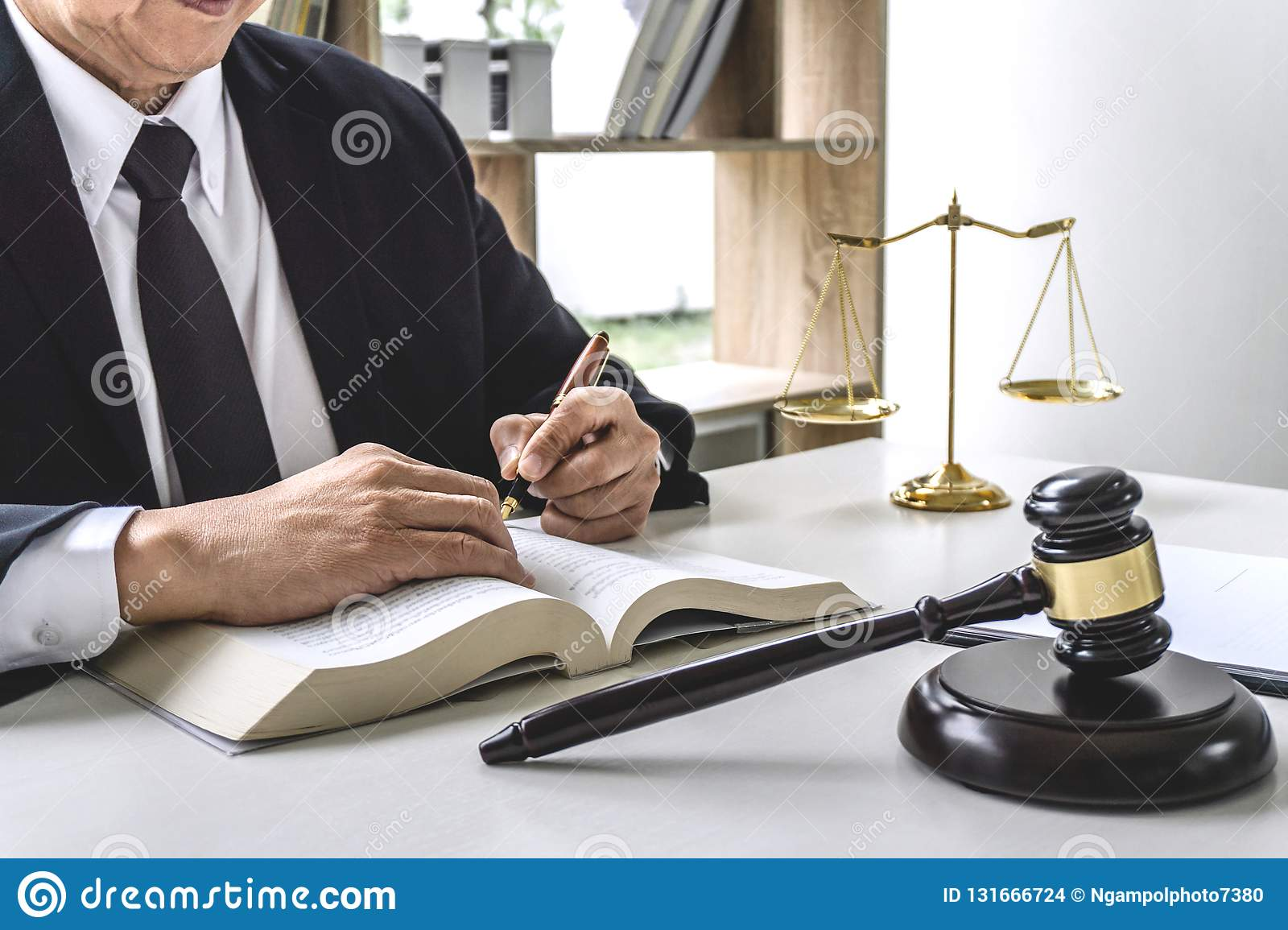 Law, Lawyer Attorney And Justice Concept, Male Lawyer Or Notary Working On  A Documents And Report Of The Important Case In The Stock Photo - Image of  barrister, counselor: 131666724