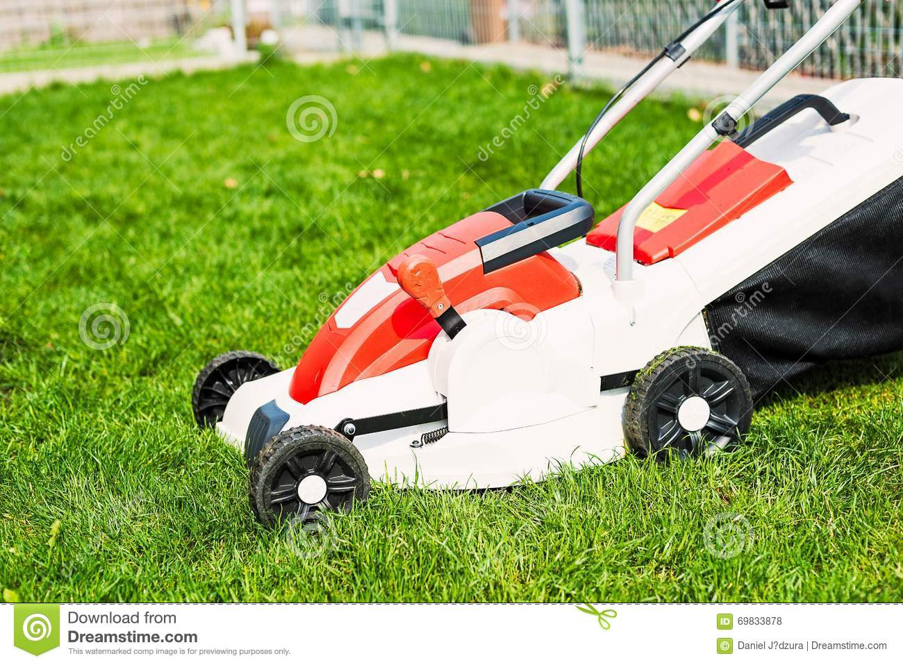 Lawn mower cutting green grass stock image for Lawn mower cutting grass