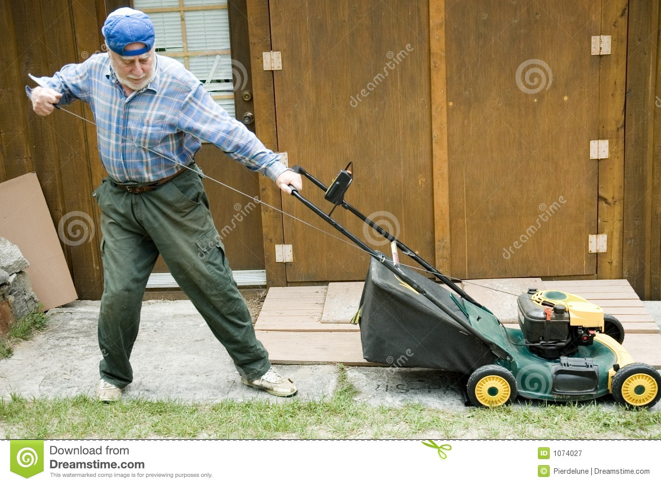 Lawn Mower Starting 2 Royalty Free Stock Photography - Image: 1074027