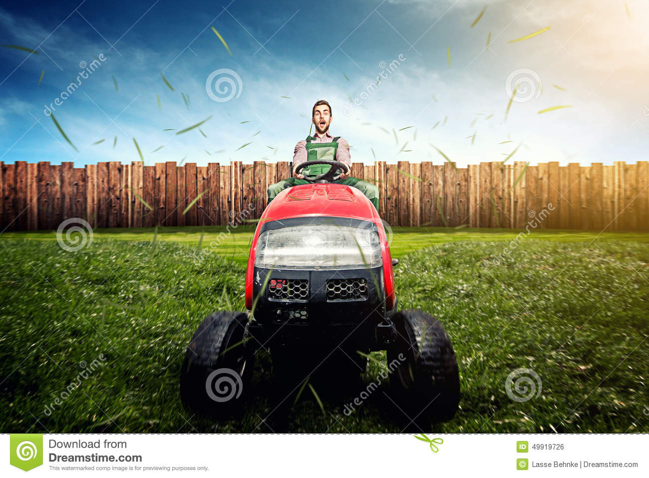 Man On Tractor Lawn Enforcment : Lawn tractor stock photo image