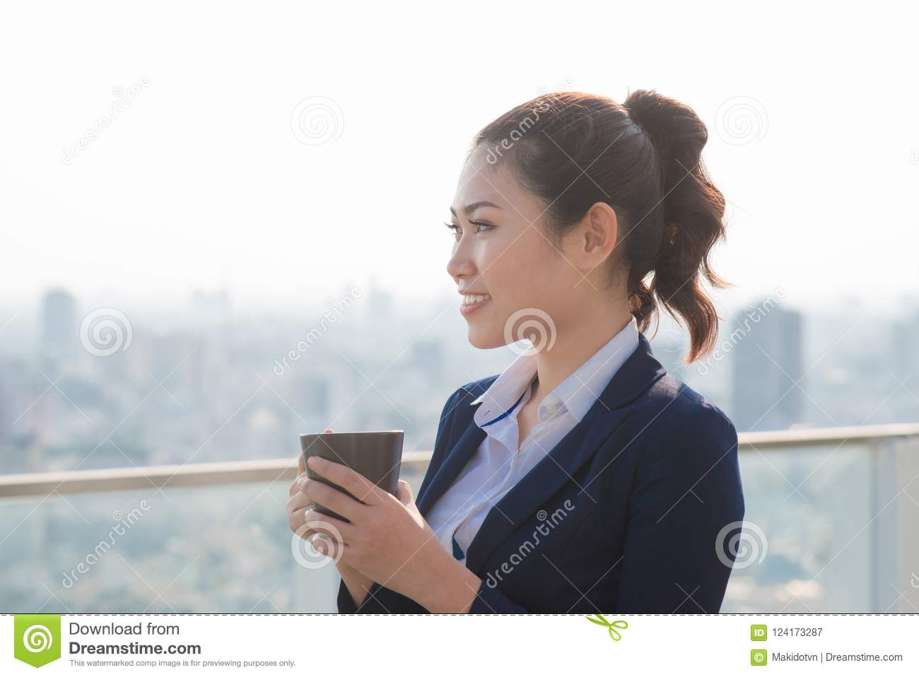 Lawyer businesswoman professional walking outdoors drinking coffee from disposable paper cup. Multiracial Asian / Caucasian