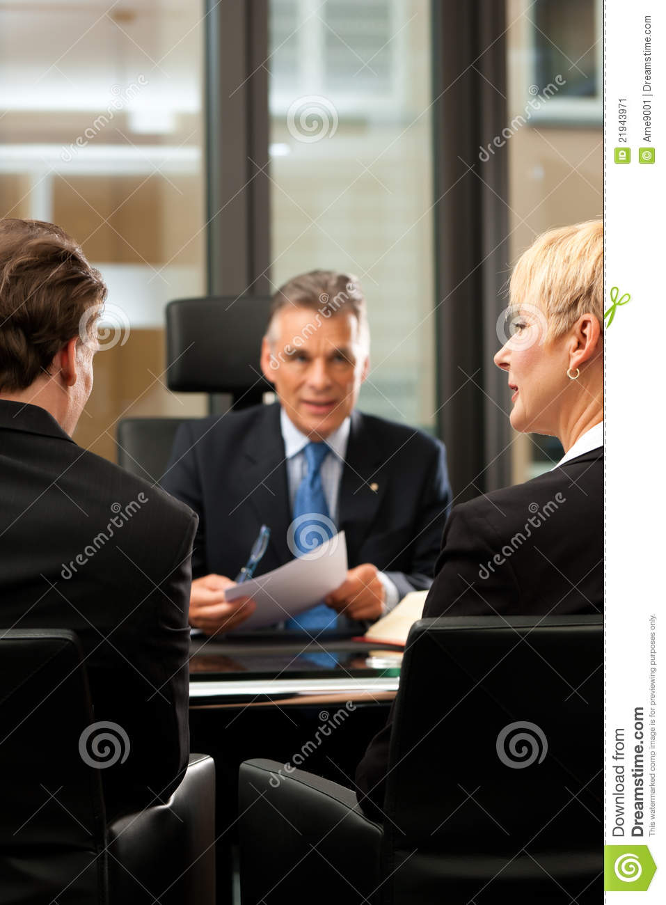 Lawyer or notary with clients in his office