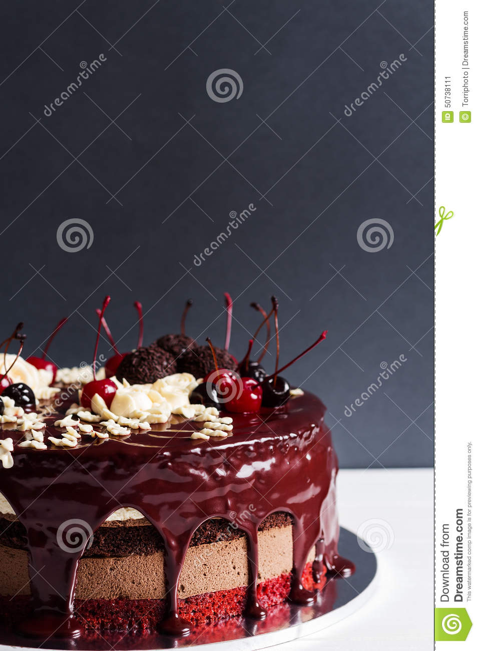 Layer Cake Decorated With Chocolate Glaze, Cream Flowers And Che Stock ...