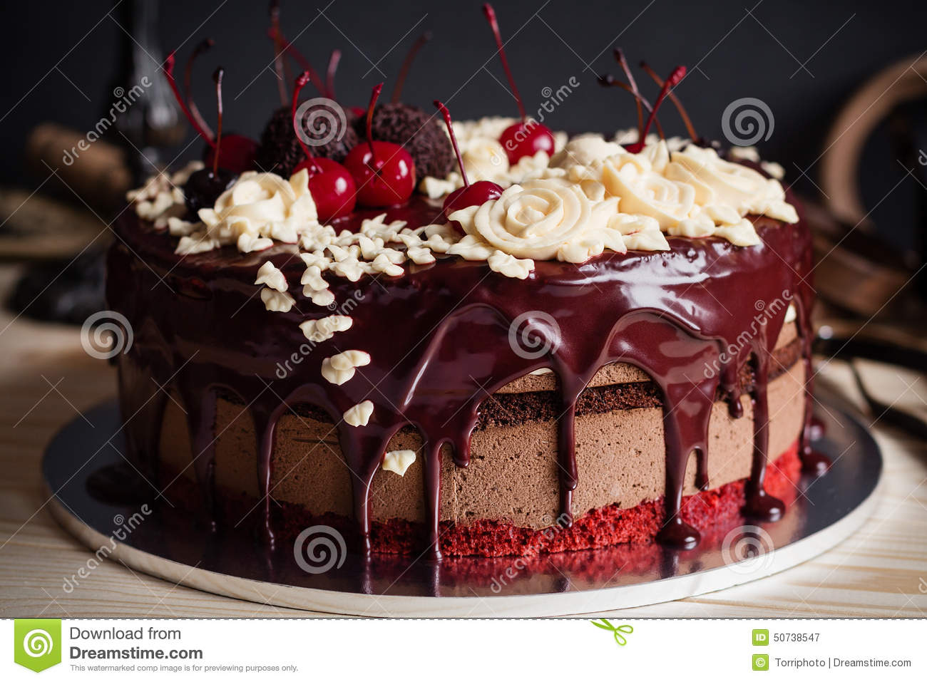 How Decorate Cake At Home : Layer Cake Decorated With Chocolate Glaze, Cream Flowers And Che Stock Photo - Image: 50738547