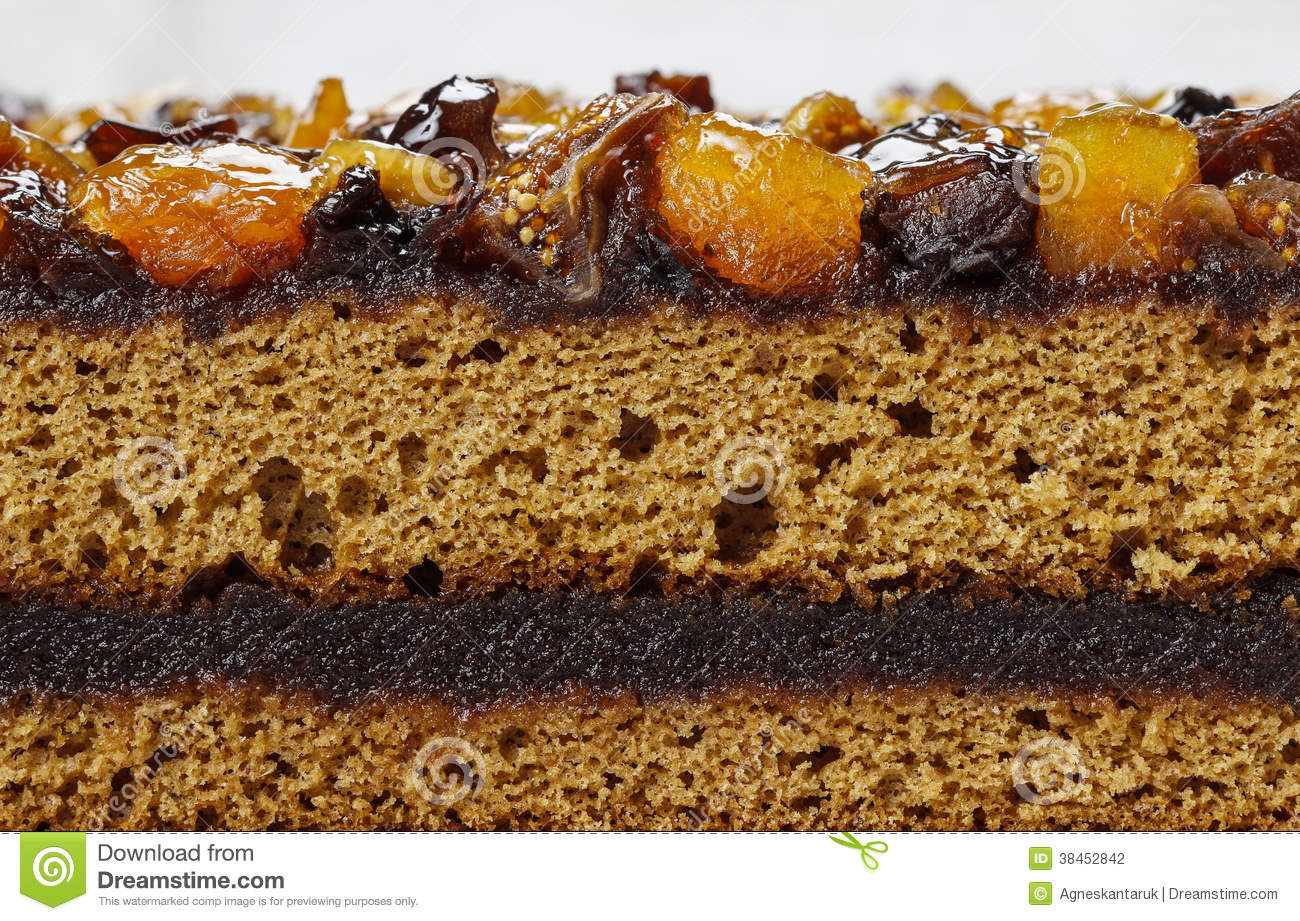 Layer cake decorated with dried fruits and honey
