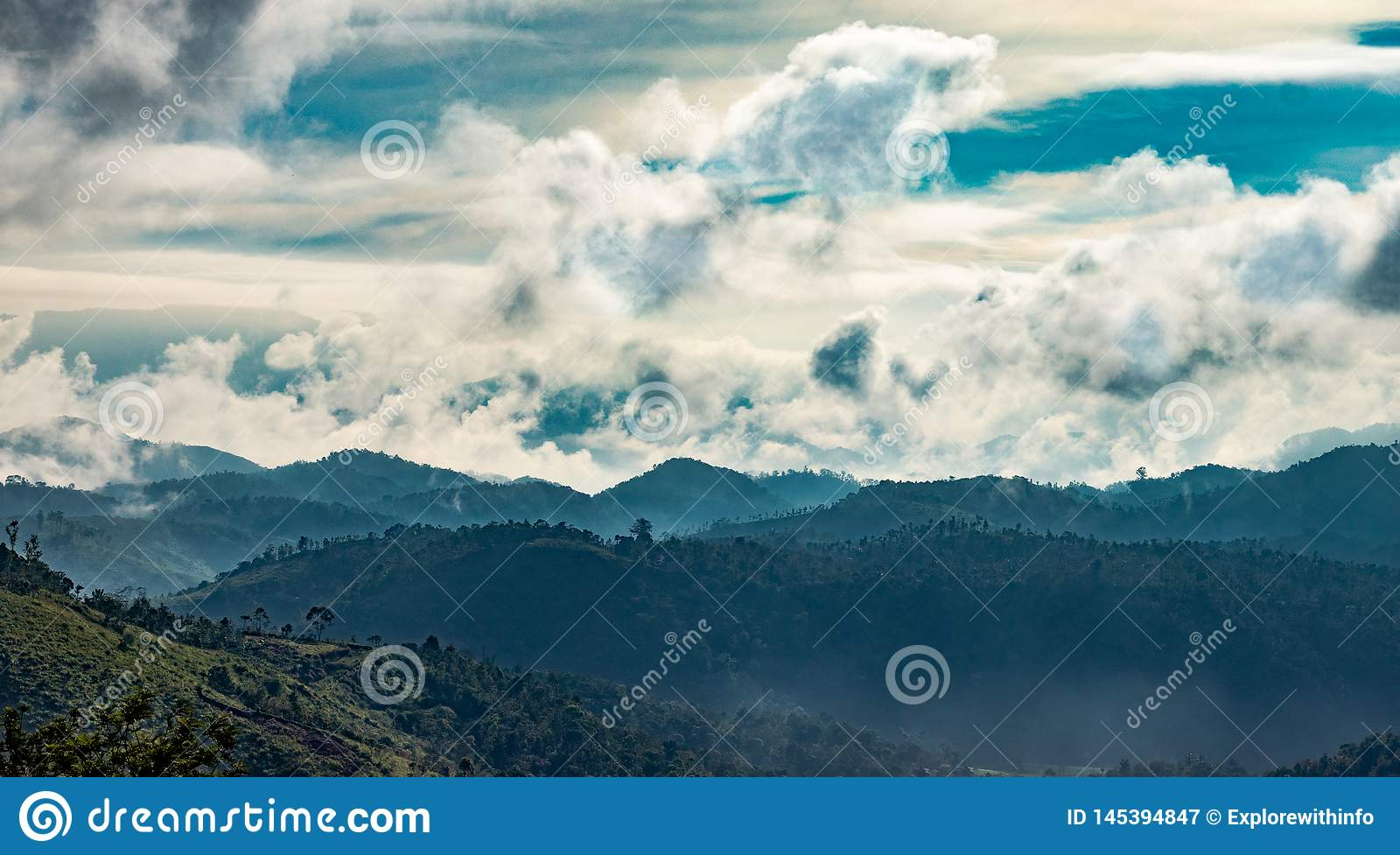 Layer of hills with clouds