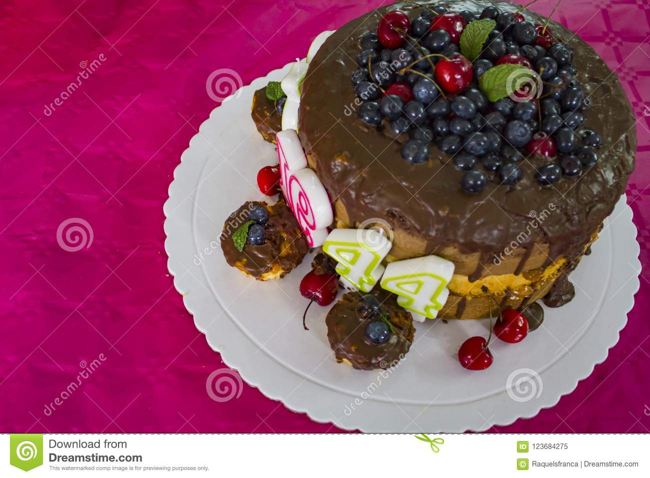 Birthday Cake With Chocolate And Red Fruits And Birthday Candles