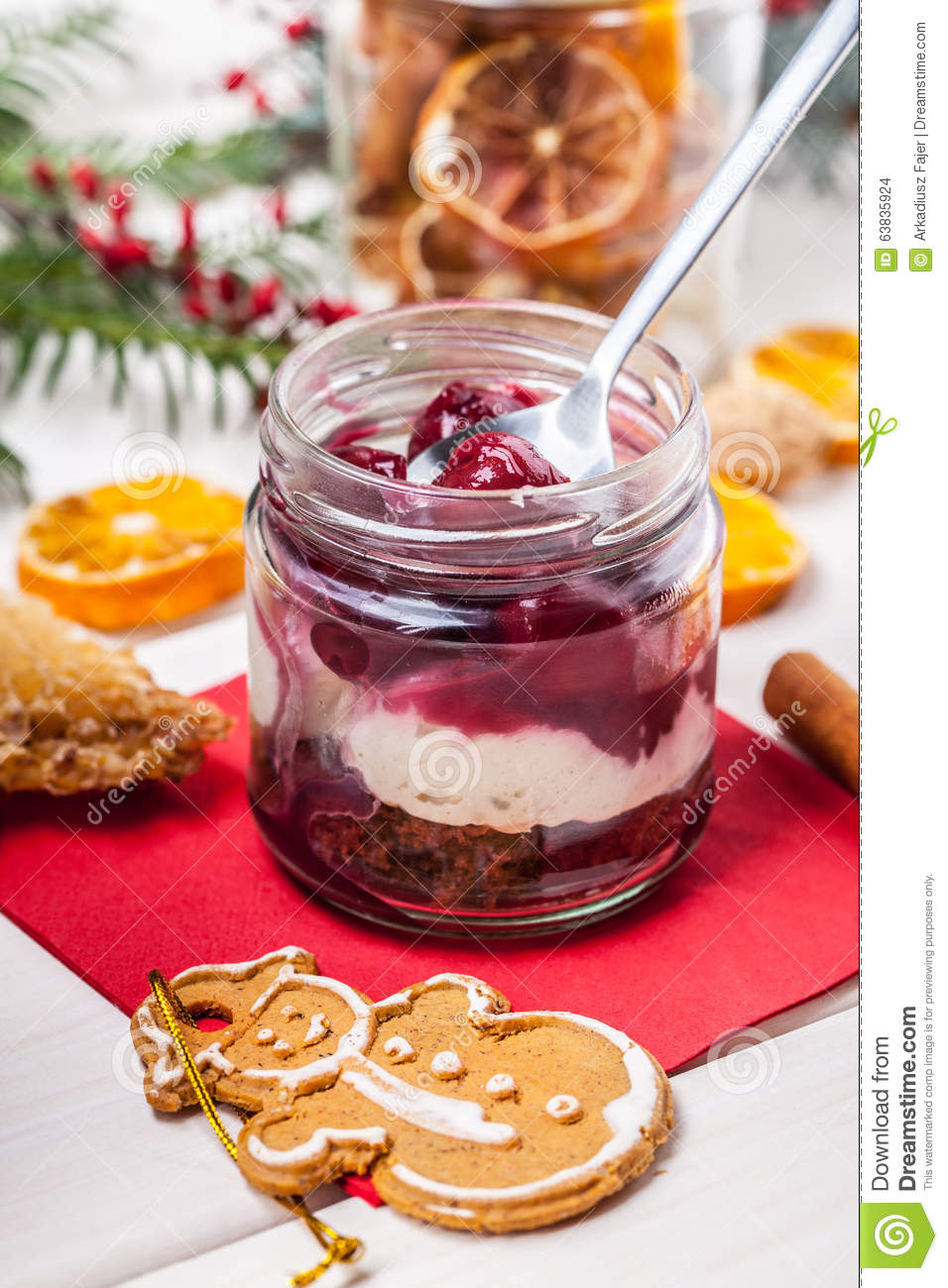 Layered dessert in a glass jar on a wooden table.