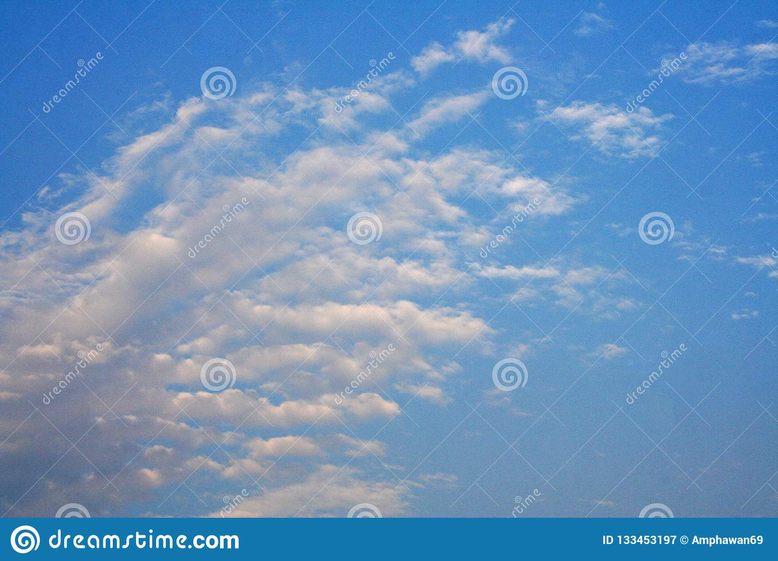 Layers of white cloud on blue sky
