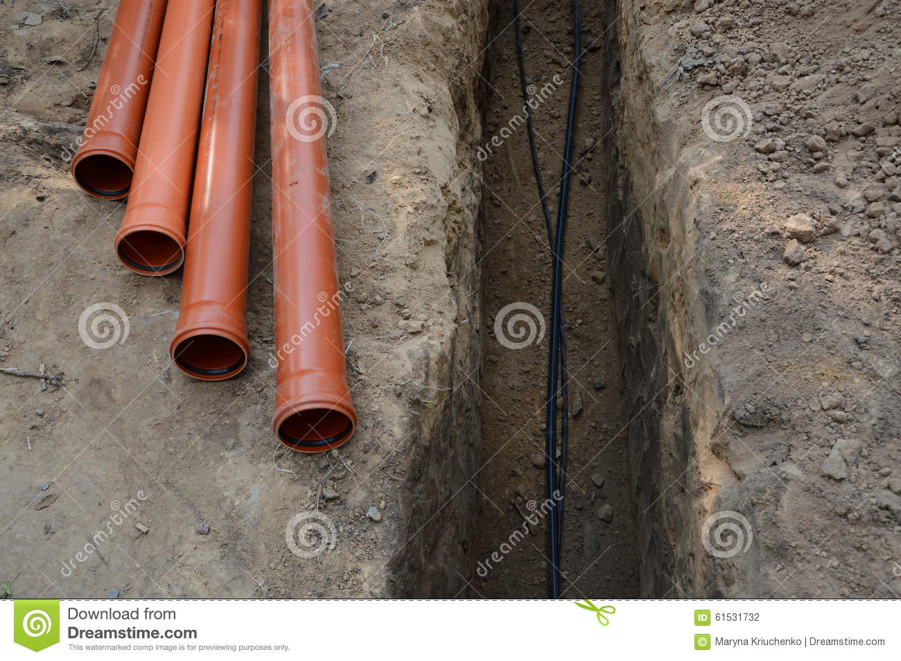 Laying Of Cables And Pipes In The Trench Stock Photo