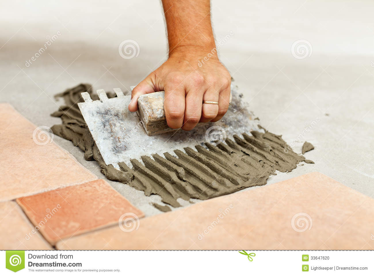 Royalty Free Stock Photo. Download Laying Ceramic Floor Tiles ...