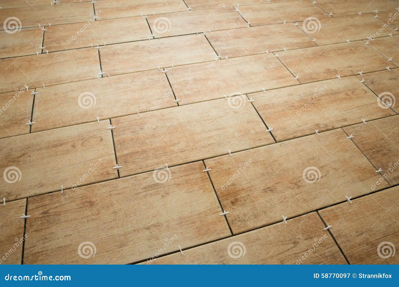 Laying Ceramic Floor Tiles Royalty Free Stock Image 33647620
