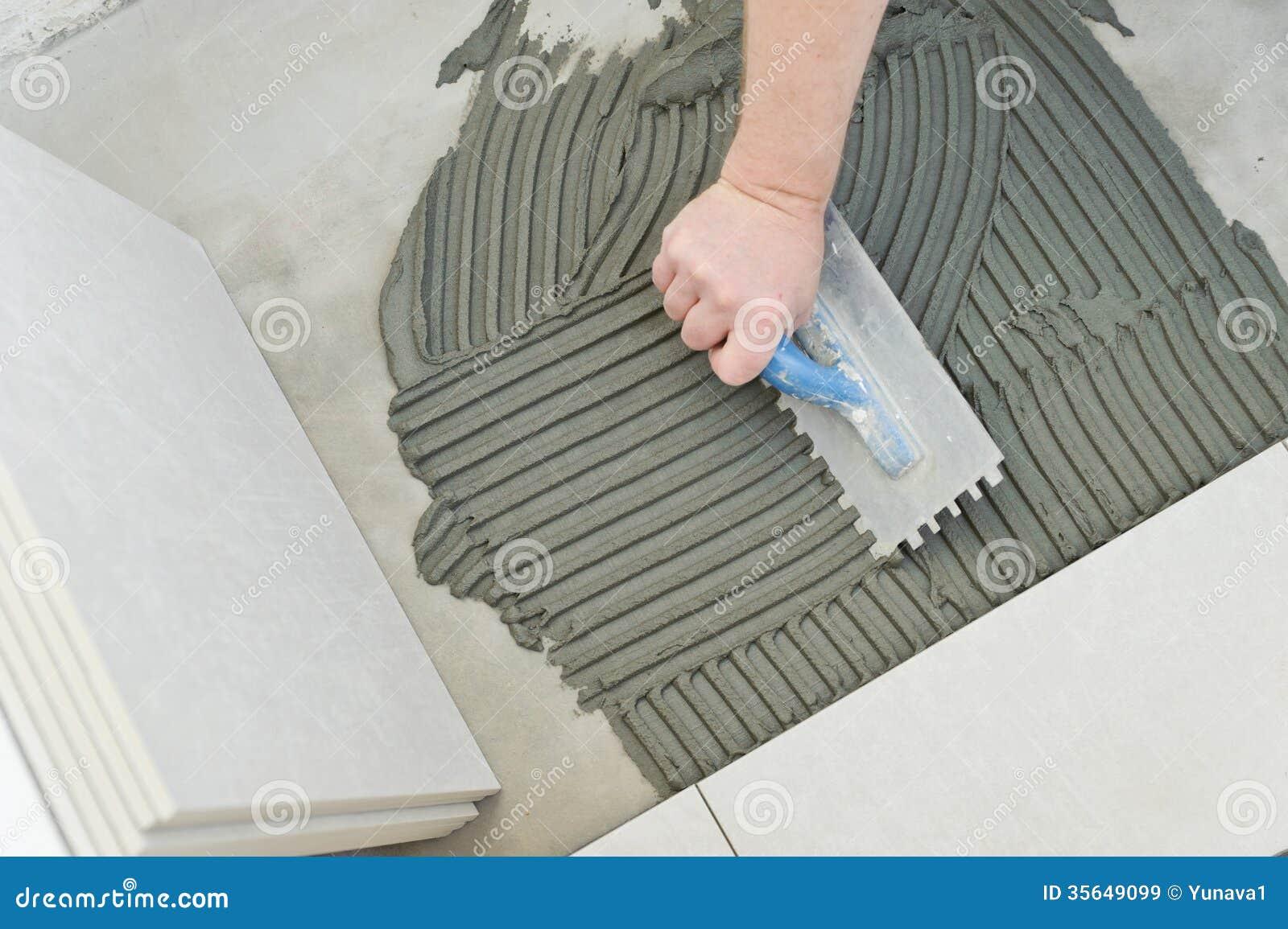 Filename: Laying Ceramic Tiles Troweling Mortar Onto Concrete Floor  Preparation White Floor Tile 35649099