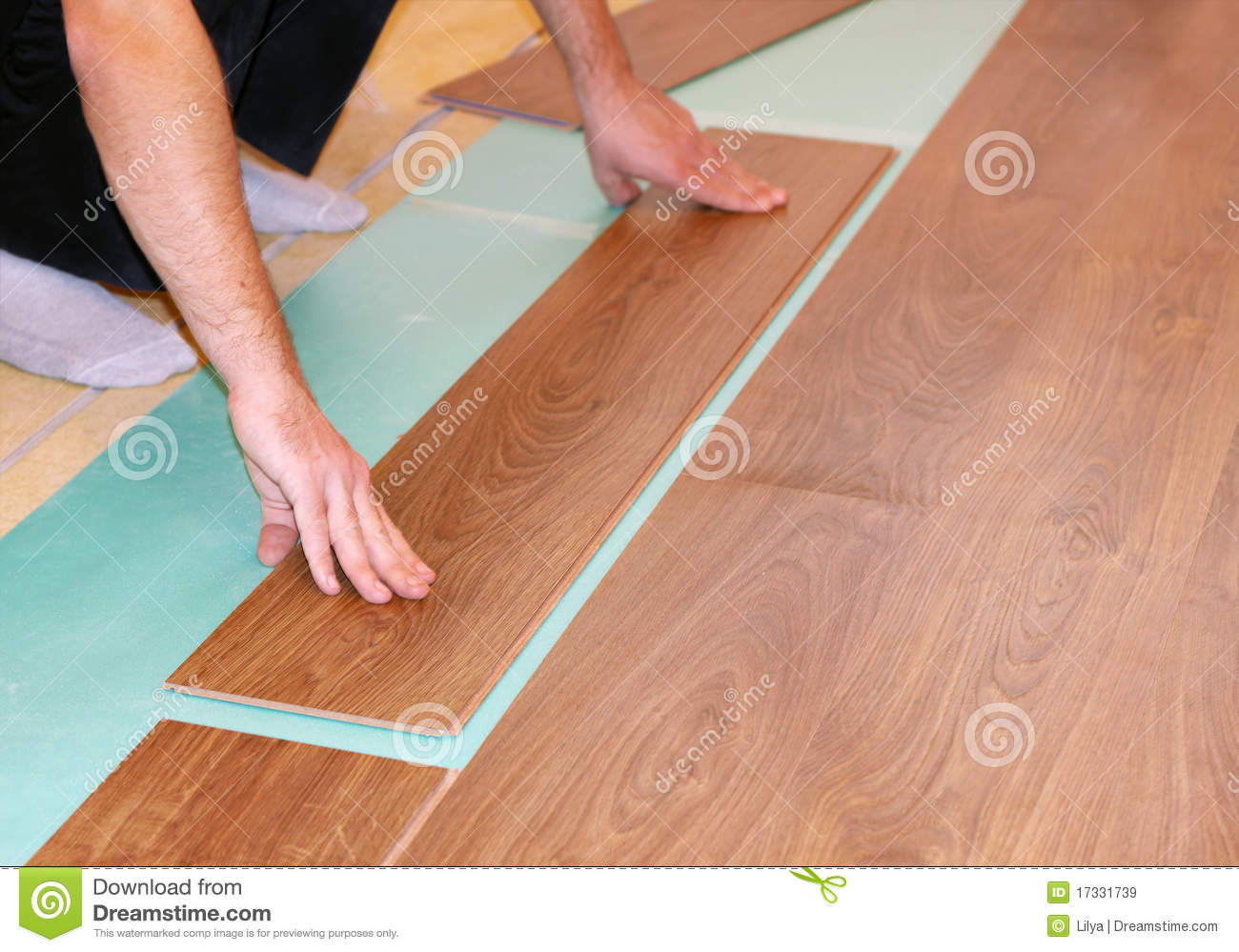 Laying laminate flooring royalty free stock images image for Laying flooring