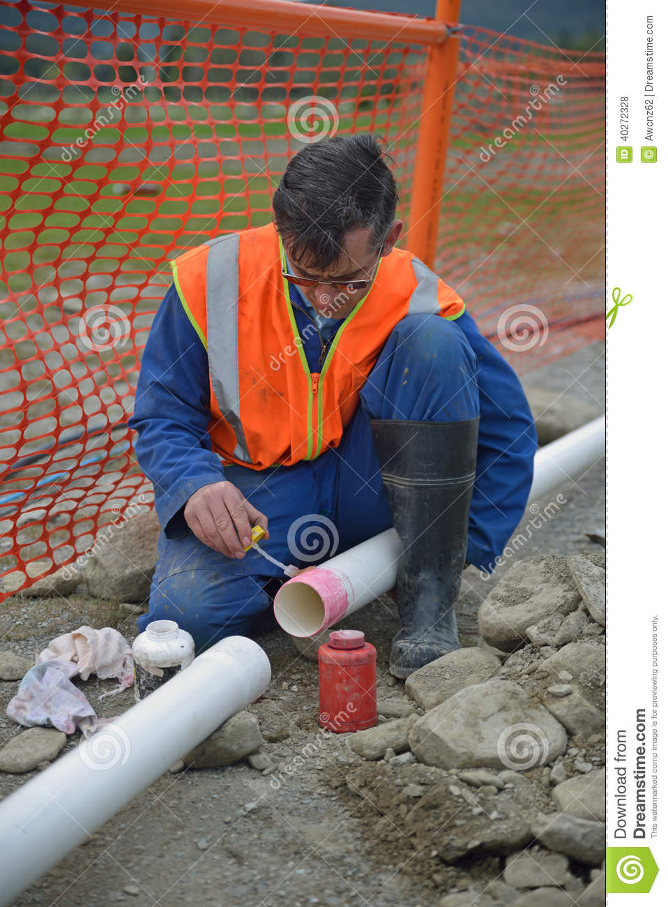 Plumber lays pipe for new client