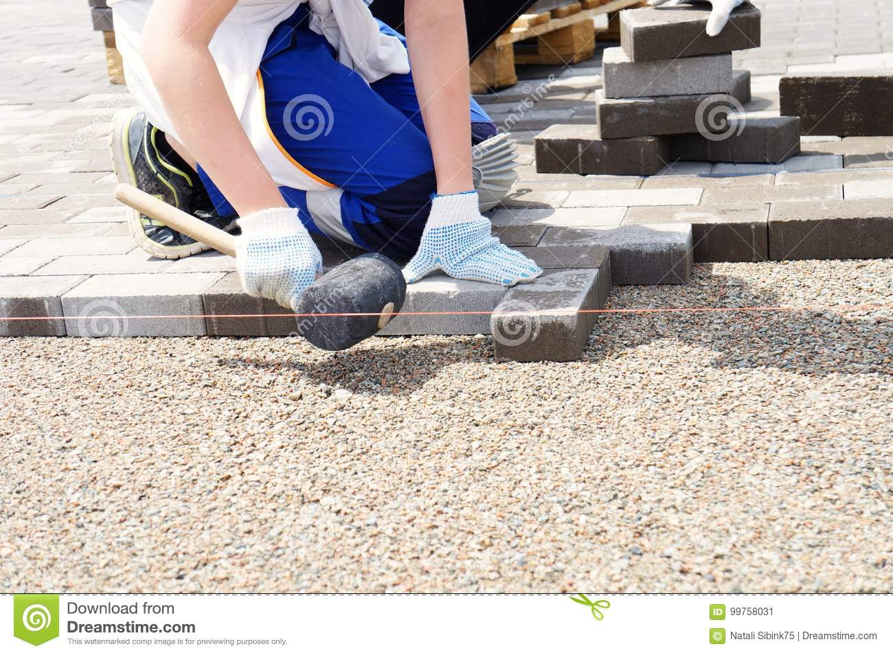 Laying pavers! stock image  Image of working, paber, stone