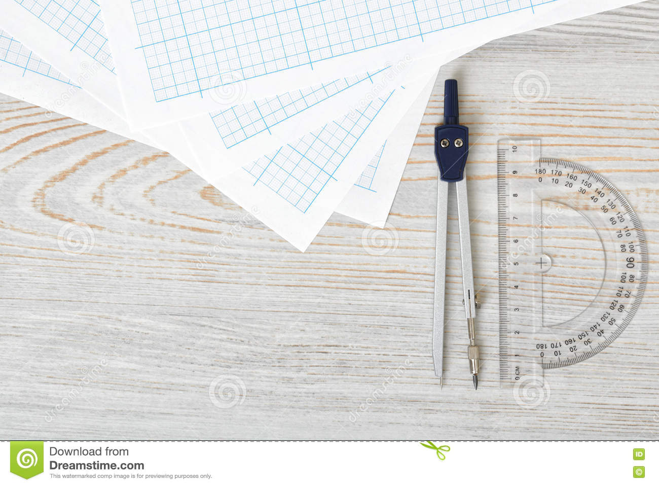 Layout With Compass, Protractor And Graph Paper On Wooden Surface In ...
