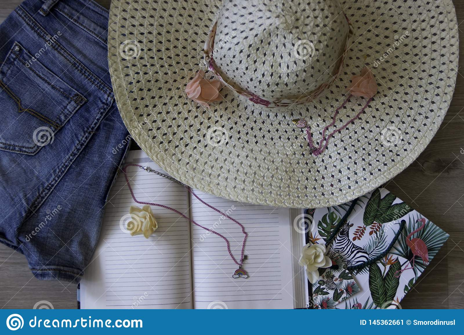 Top View Travel Concept Lifestyle Jeans,Hat on Wood Background