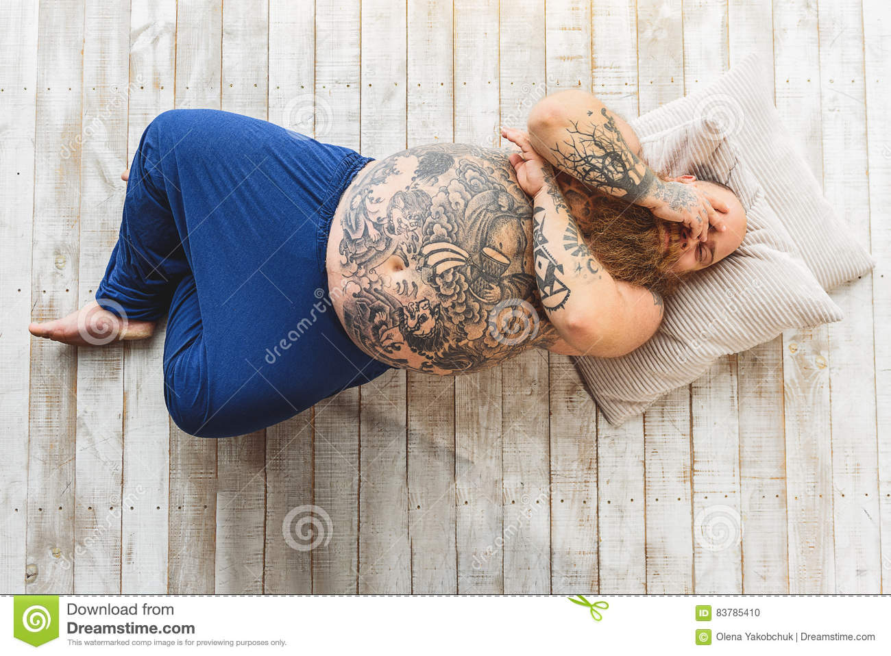 lazy fat man is lying on floor stock photo - image of exhaustion