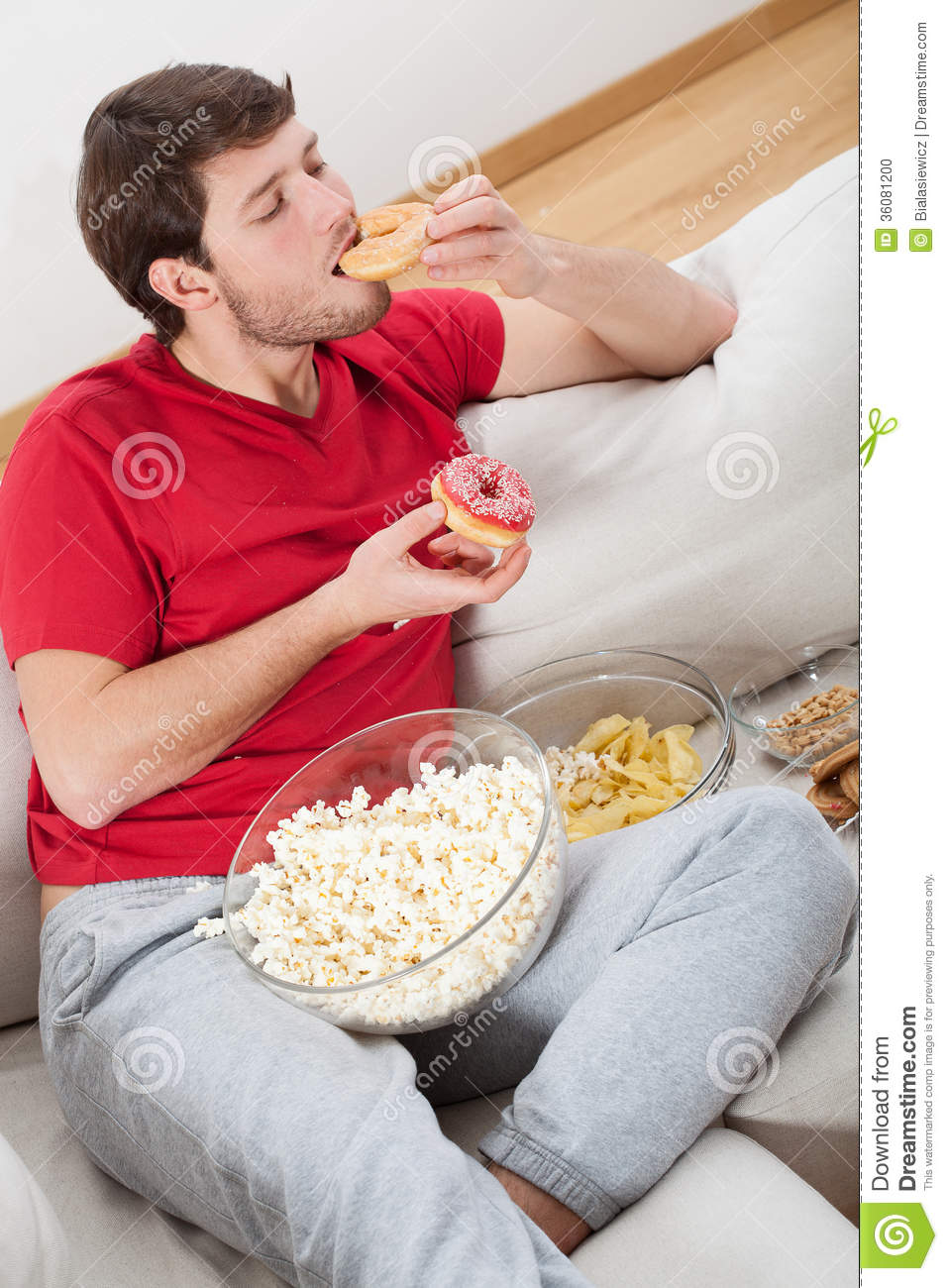 Lazy Guy On A Couch With Food Stock Photo - Image: 36081200