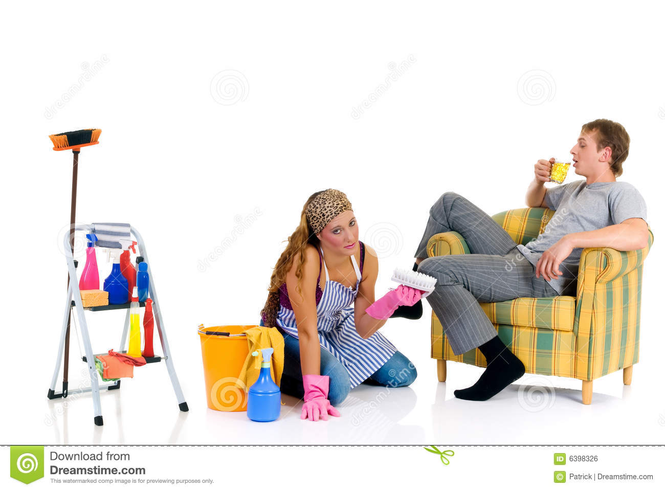 Young couple, housewife attending to household, lazy husband in sofa ...