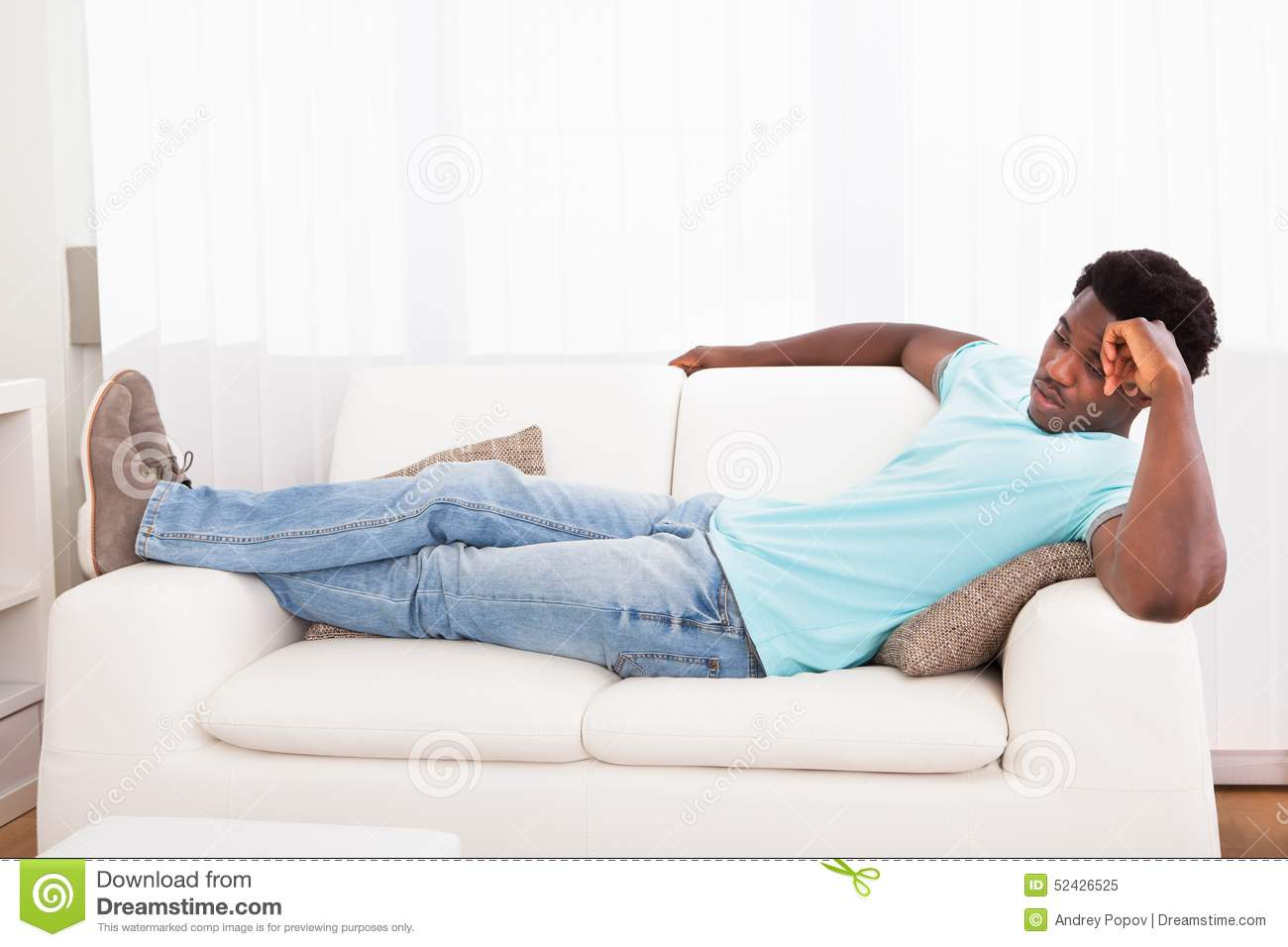 lazy man chilling out on sofa stock photo image 52426525. Black Bedroom Furniture Sets. Home Design Ideas