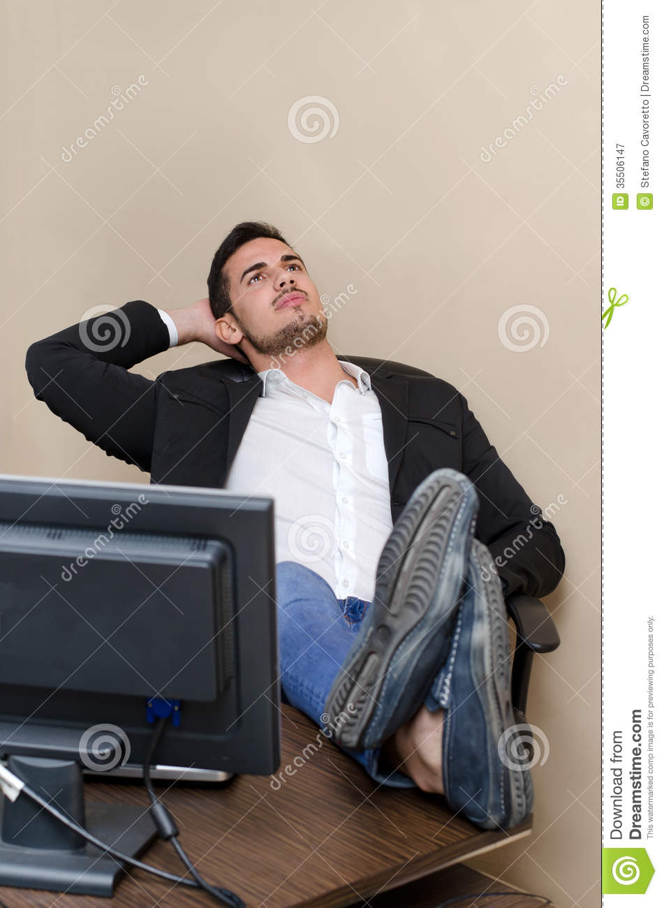 Lazy Office Worker Resting Feet On The Desk Royalty Free