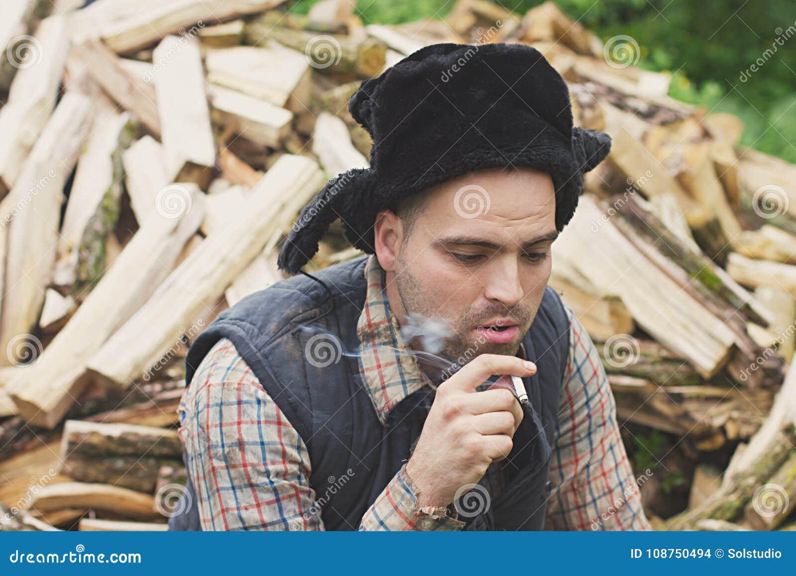 Leñador en el sombrero foto de archivo. Imagen de varón - 108750494 c9906a96ab4