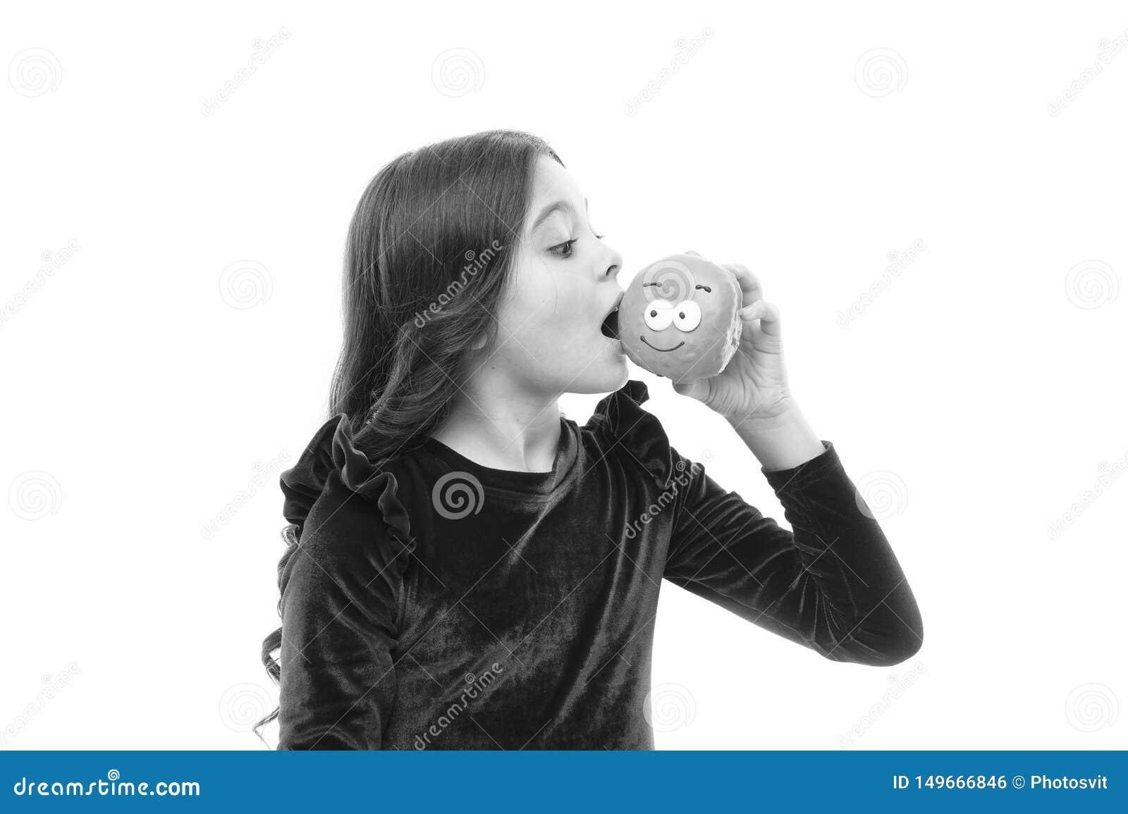 Le beignet deviennent si populaire Niveaux de sucre et nutrition saine Enfance heureux et festins doux Beignet cassant le r?gime