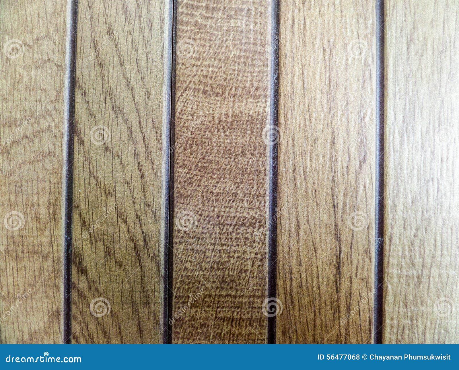 Le bois rapièce les textures brunes et la pierre de morceaux