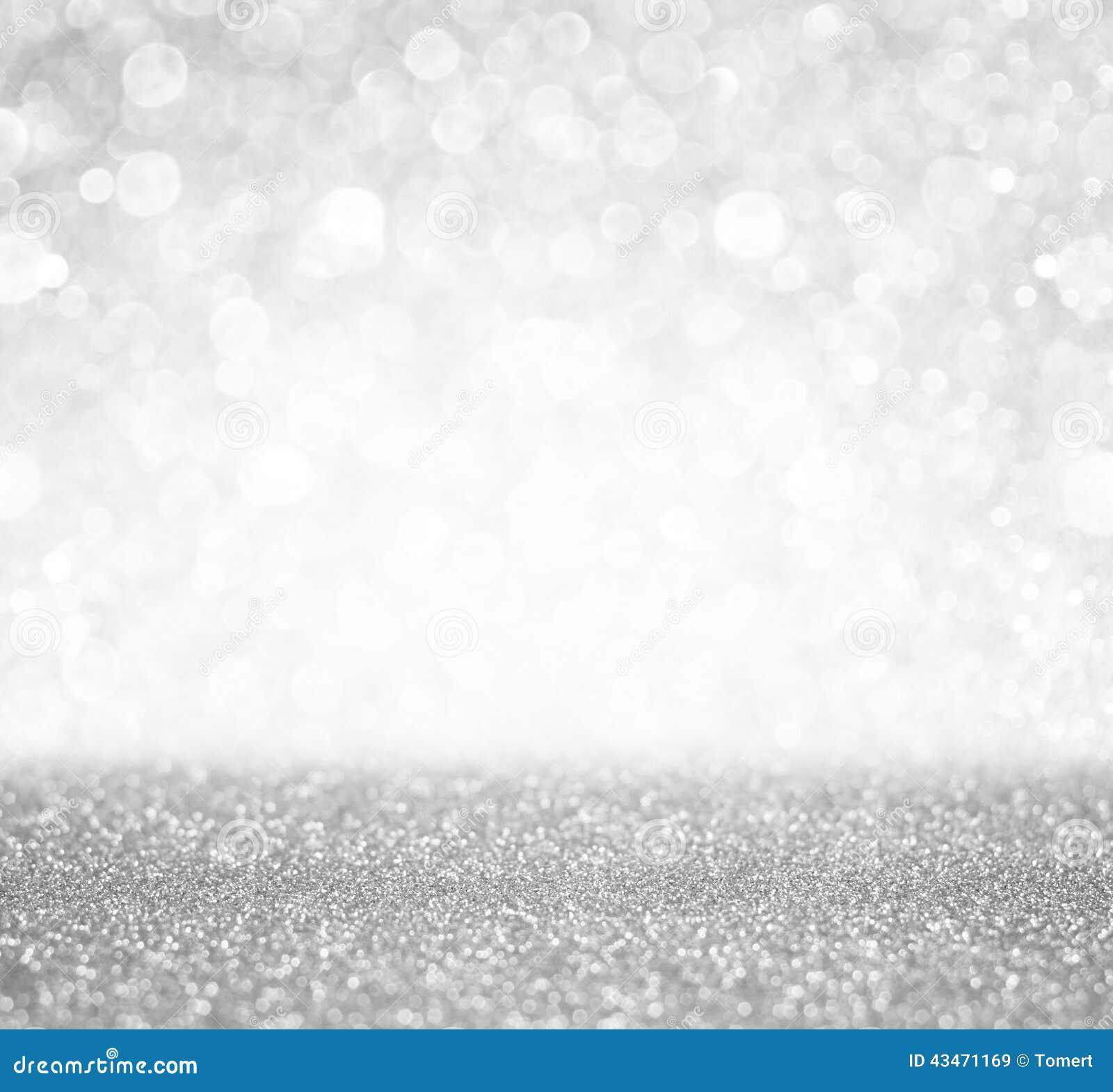 Le bokeh argenté et blanc allume defocused abrégez le fond