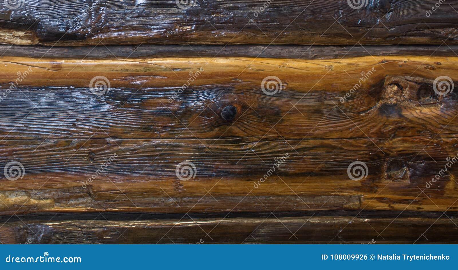 Le chêne en bois verni de brun foncé, fond