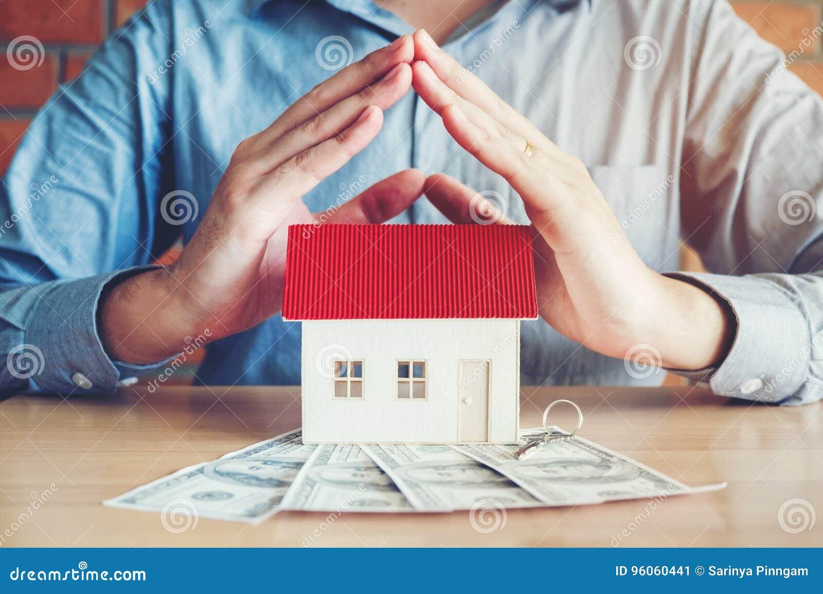 Le concept du propriétaire de logement et de billets d un dollar