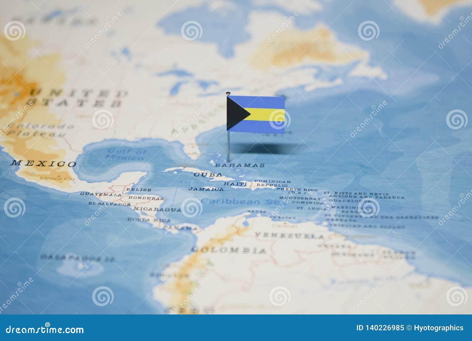 Carte Du Monde Bahamas.Le Drapeau Des Bahamas Dans La Carte Du Monde Image Stock
