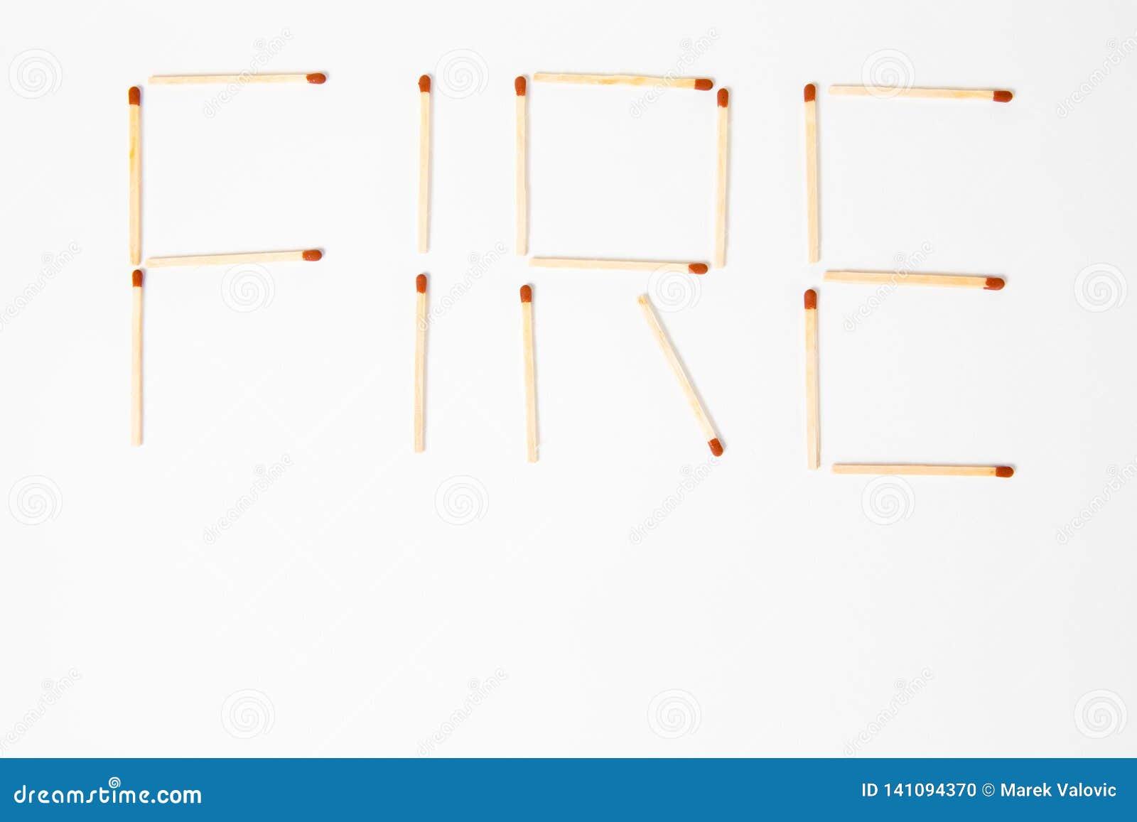 Le FEU d inscription écrit avec les matchs en bois - pour maintenir hors de portée des enfants