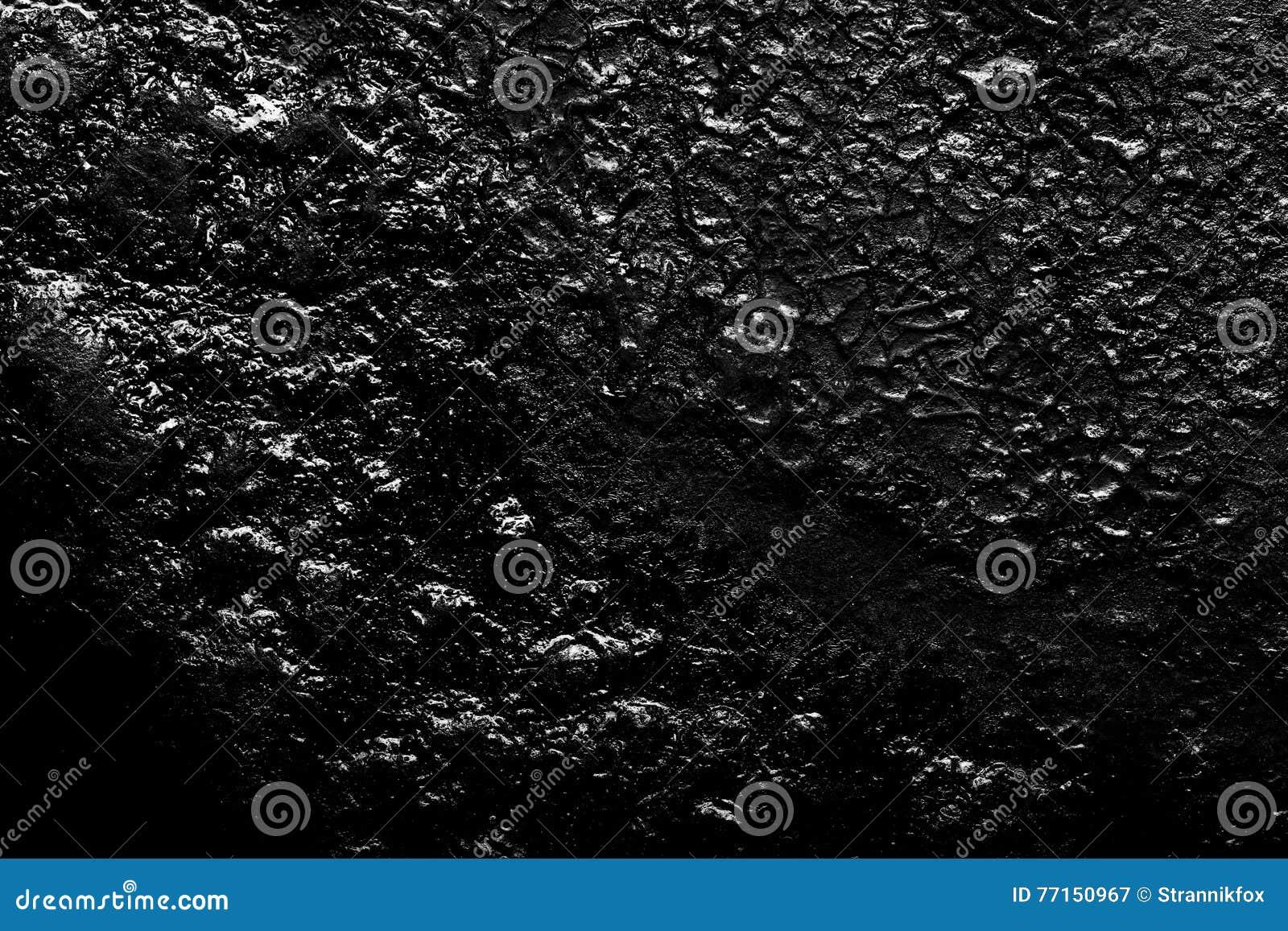 Le fond de la vieille poêle de fonte toned