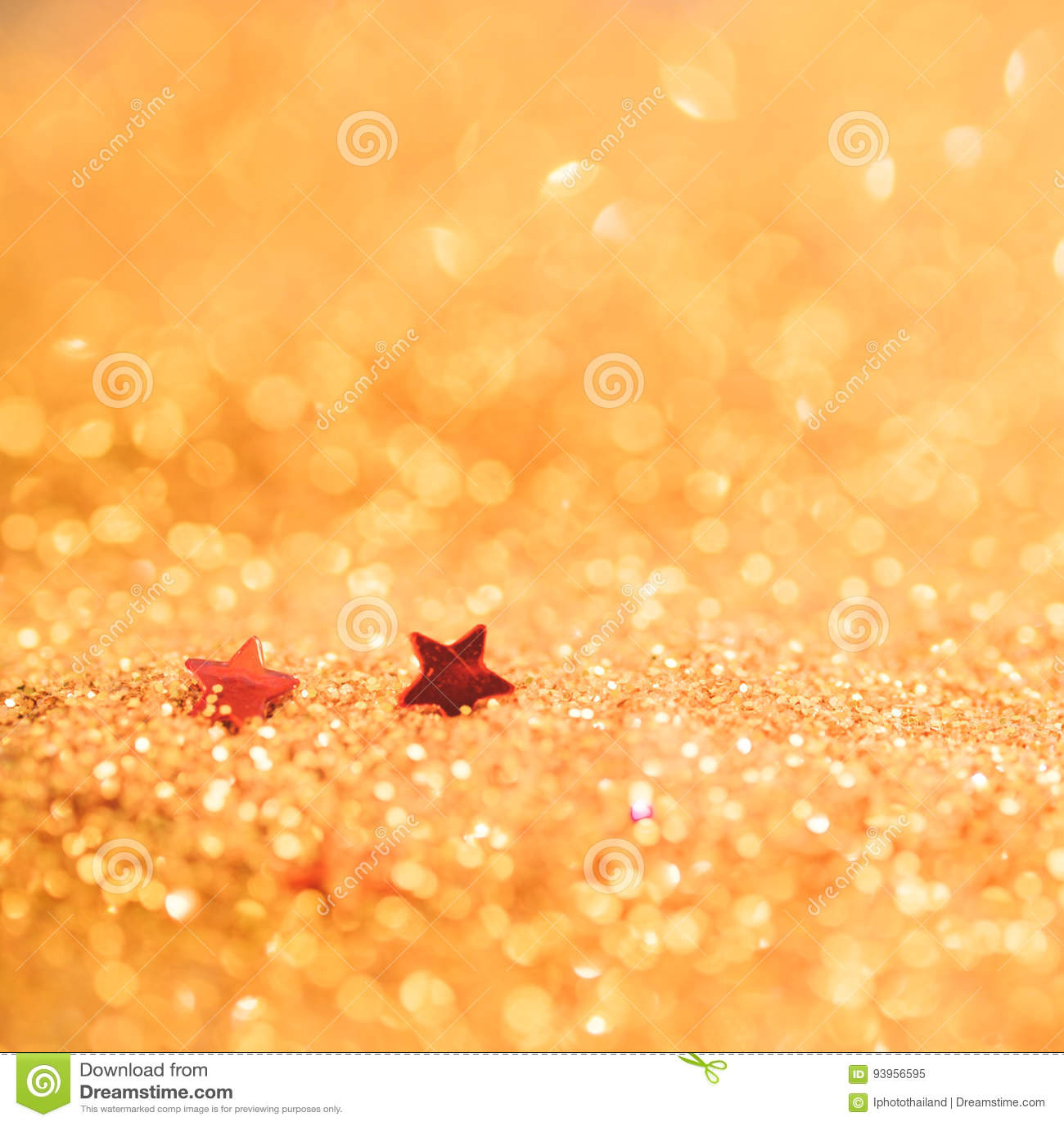 Le foyer mou et l image sélective sur l étoile rouge sur l or allument le bokeh t