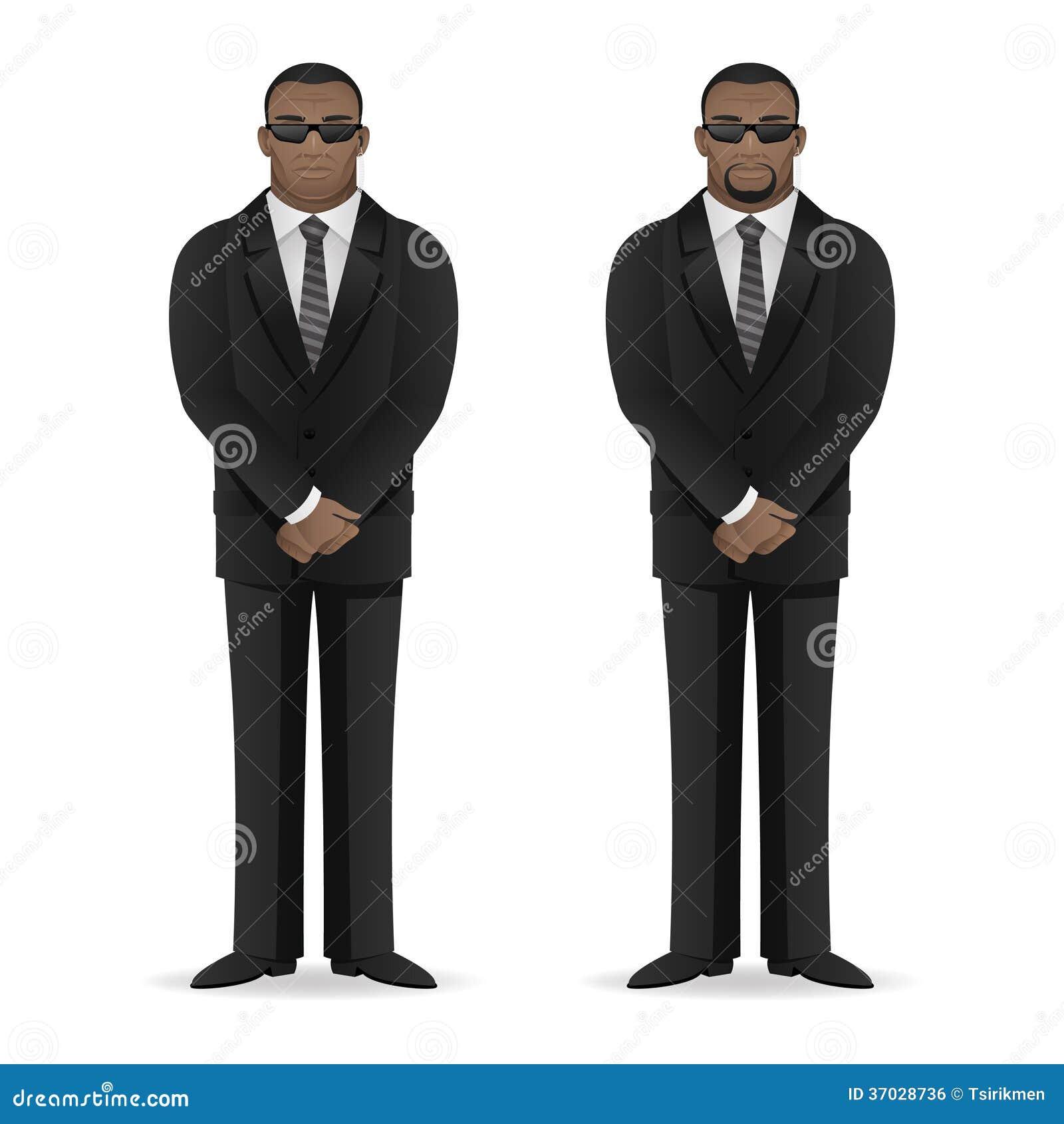 le garde du corps d 39 homme de couleur se tient dans la pose. Black Bedroom Furniture Sets. Home Design Ideas