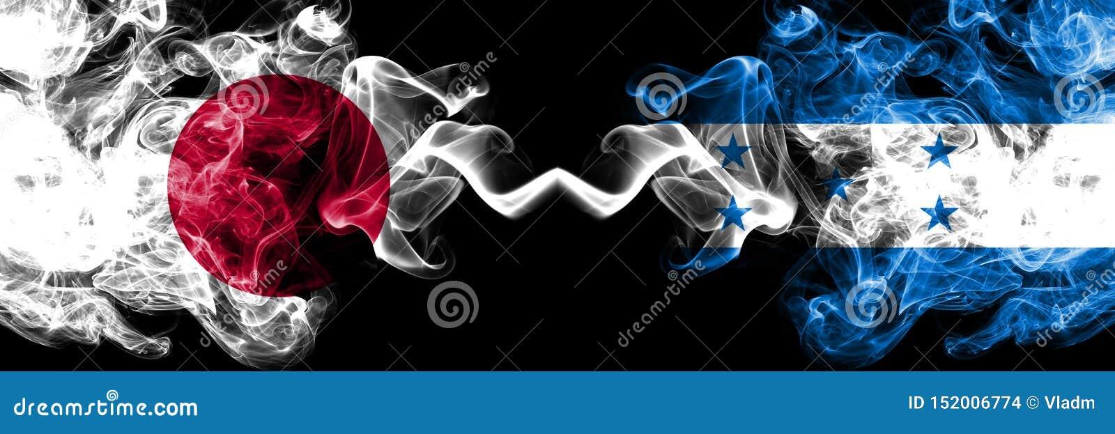 Le Japon contre le Honduras, drapeaux mystiques fumeux honduriens placés côte à côte Épais coloré soyeux fume la combinaison du H