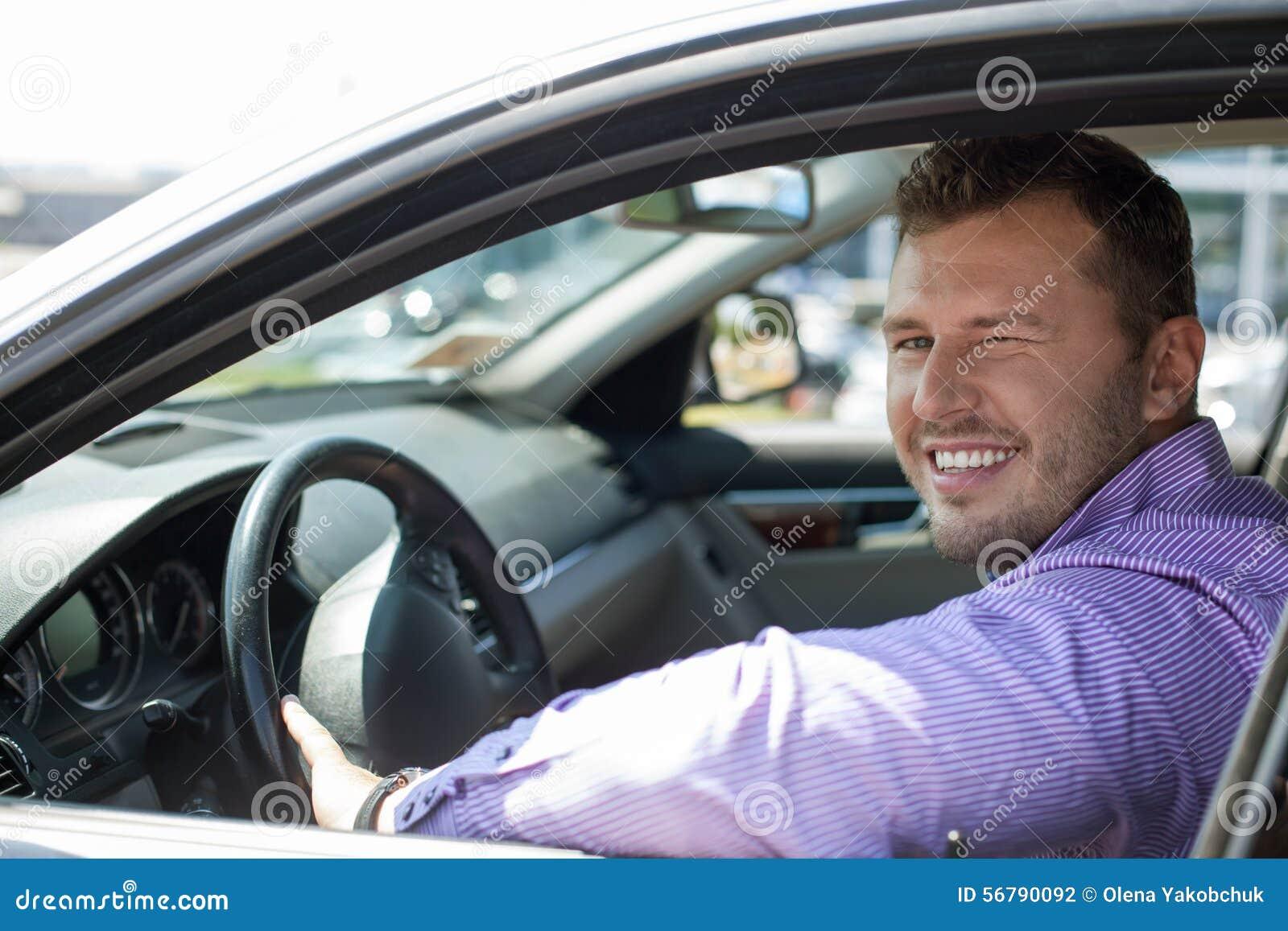 le jeune homme beau conduit sa voiture photo stock image 56790092. Black Bedroom Furniture Sets. Home Design Ideas
