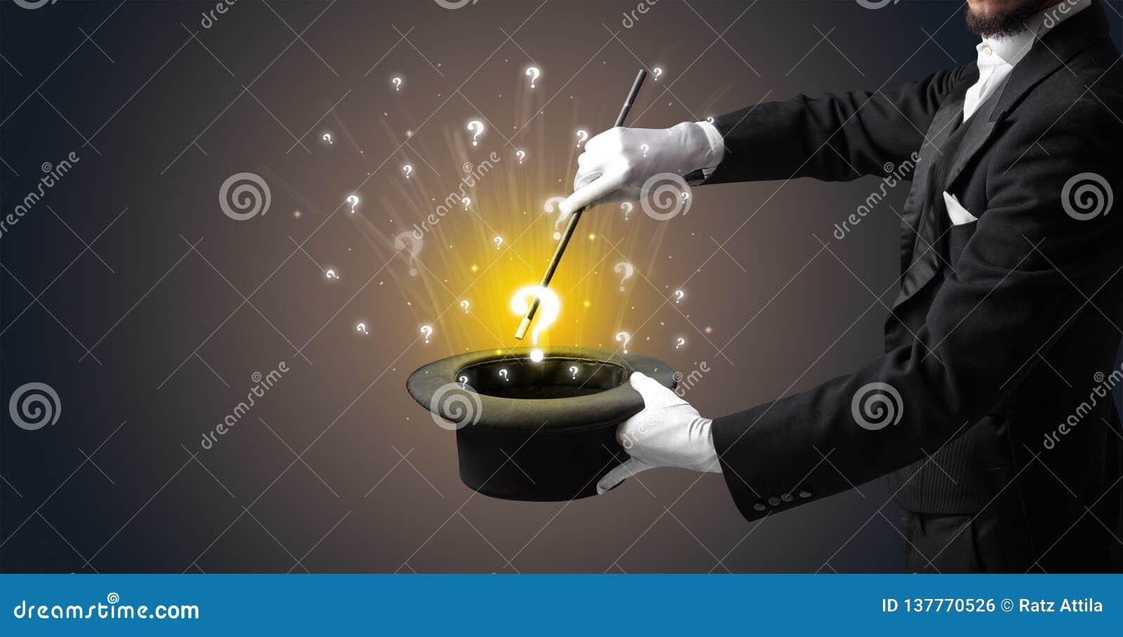 Le magicien créent des signes de question d un cylindre