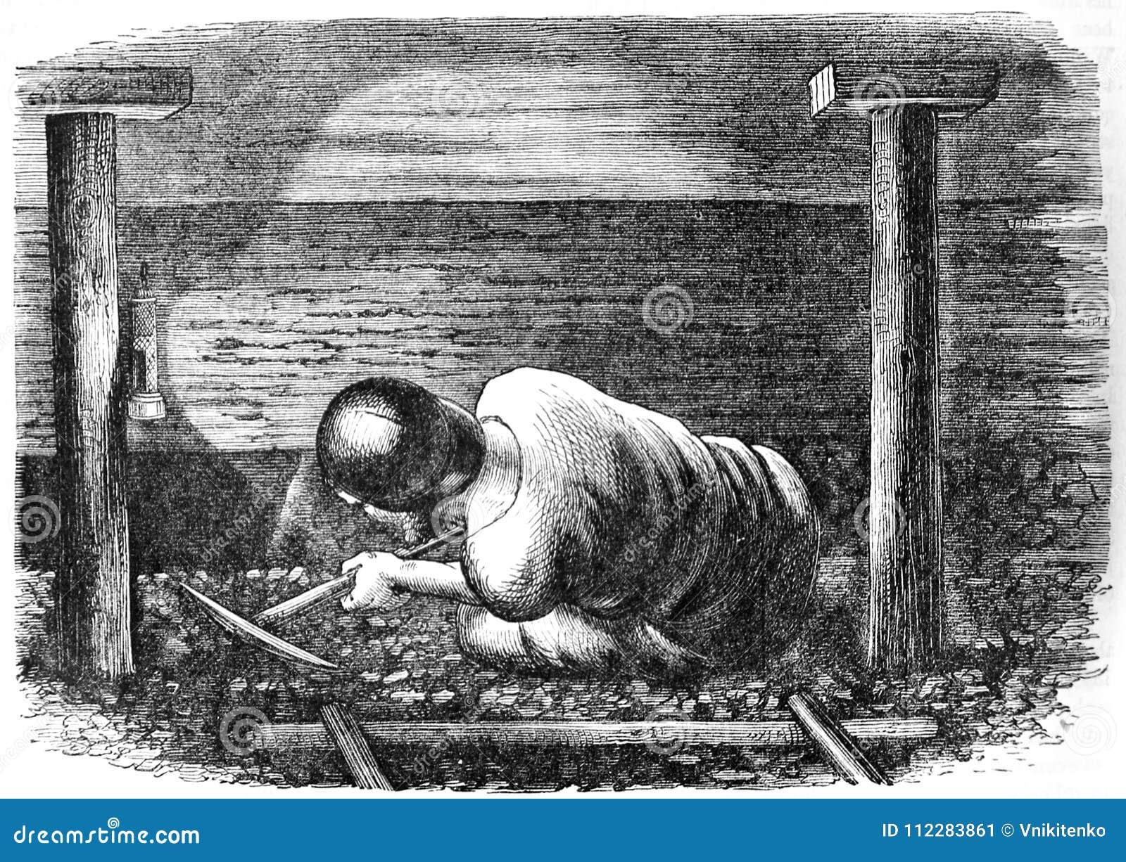 Le mineur extrait le charbon profondément sous terre