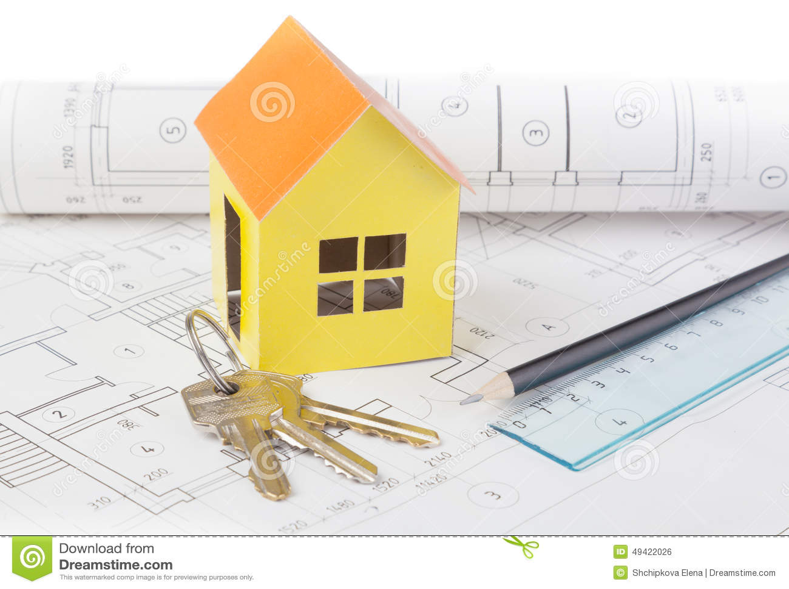 Le modèle de papier de la maison coûte sur le plan de construction photo stock